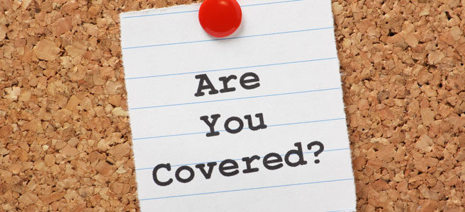 Are you Covered? note pinned to board